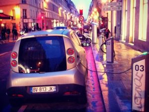 An electric, shared vehicle from Paris, France's, Autolib' car-sharing service charges at a docking station. While still primarily concentrated in North America and Europe, car-sharing is steadily becoming an increasingly globalized industry. Photo by Cokul/Flickr.