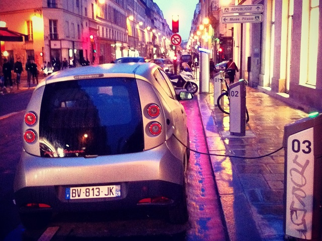 An electric Autolib' vehicle charges in Paris, France. Photo by Cokul/Flickr.