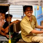 An auto-rickshaw carries young passengers in Chennai, Tamil Nadu, India. Chennai's auto-rickshaw sector has undergone many recent improvements, yet fleet service implementation should be considered as a means to ensure high-quality service for passengers. Photo by Kamakshi Sachidanandam/Flickr.