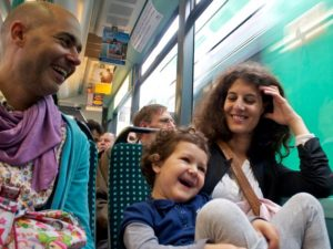A family travels by train in Germany. There are many co-benefits to sustainable transport, including ditching the stress of family road trips. Photo by Edo Medicks/Flickr.