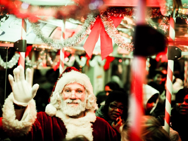 """Santa waves from Chicago's """"Santa Train."""" Photo by Boqiang Liao/Flickr."""