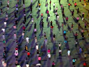 Dancers gather in Shenzhen, China's Futon Cheng square. Dancing in public spaces is a popular pastime in China, particularly among seniors, but it has sparked recent controversies and highlighted the country's challenge of designing socially inclusive cities. Photo by dcmaster/Flickr.