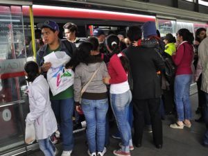 A crowd of passengers boards the TransMilenio BRT in Bogotá, Colombia. Despite new, larger buses operating within the TransMilenio system, Bogotá still faces significant challenges to providing sustainable urban mobility options for its urban residents. Photo by Mariana Gil/EMBARQ Brazil.