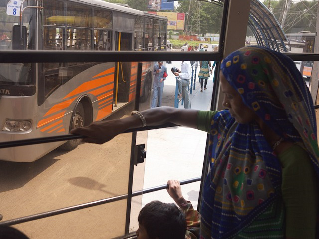 Passengers ride Ahmedabad, India's BRT. Photo by EMBARQ.