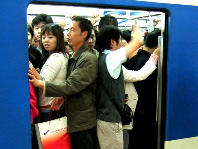 Crowded subway car in Beijing, China. Photo by Filipe Fortes/Flickr.