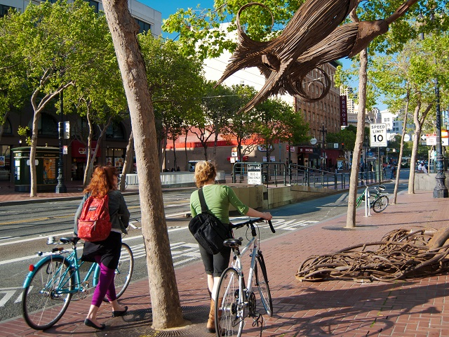 Two cyclists on Market Street in San Francisco, California. Photo by Sergio Ruiz/Flickr.