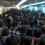 Passengers are crowded during rush hour at Guomao Station of Beijing, China's subway. In an effort to mitigate congestion, poor quality of service, and costly subsidies, Beijing's municipal government has proposed a subway fare increase. Photo by Jens Schott Knudsen/Flickr.