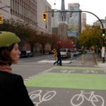 Separated bike lane on Dunsmuir Street in Vanouver, Canada. Photo by Paul Krueger/Flickr. Cropped.