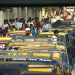 Pedestrians passing across a congested road in Mumbai, India. Photo by Jerry H/Flickr.