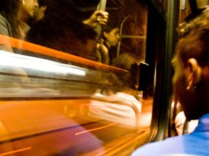 A person looks out the window of a bus in Brazil. Many countries are moving towards a more human-centered transport policy. Photo by Carolina Pitanga/Flickr.