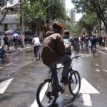 A person bikes in Bogota, Columbia, during the city's car-free week. The city's car-free streets simultaneously promote social equality, a vibrant economy, and a sustainable environment. Photo by M.Erwert/Flickr.