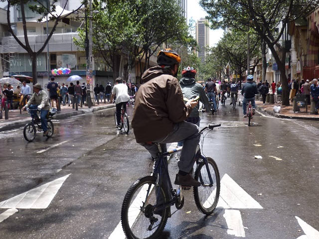A person bikes in Bogota, Columbia, during the city's car-free week. Photo by M.Erwert/Flickr.