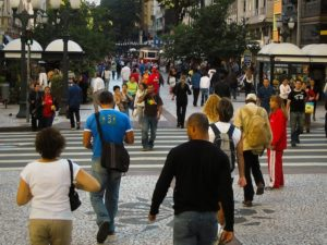 Pedestrians walk along Rua XV in Curitaba, Brazil. Even among strangers, eyes on the street provide safety in public spaces. Photo by Dylan Passmore/Flickr.