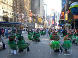 Lawn chairs are placed in Times Square to foster human interaction in the city. Photo by Kathy Silberger/Flickr.