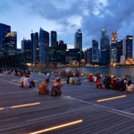 A crowd gathers overlooking Singapore's Marina Bay. Since the inception of its 1971 Concept Plan, Singapore has become one of the most sustainability-oriented cities in the world. Photo by Nicolas Lannuzel/Flickr.