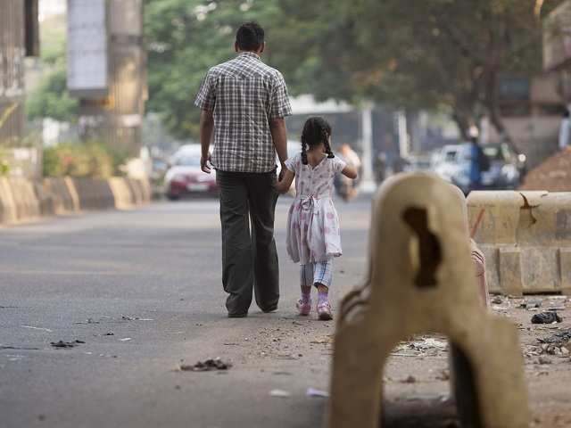 By reorienting Bangalore's transport network to focus on people instead of cars, the city can give the children access to greater opportunities for their future. Photo by Benoit Colin/EMBARQ.