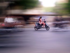 As the two-wheeler sector continues to expand in India, researchers study the demographics of two-wheeler users and their possible role in promoting sustainable mobility. Photo by Meghana Kularni/Flickr.""