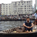 The Buriganga River in the Bangladeshi city of Dhaka provides transport for the city---yet reminds Dhaka's residents of the need to build resiliency into the city as water levels rise. Photo by William Veerbeek/Flickr.