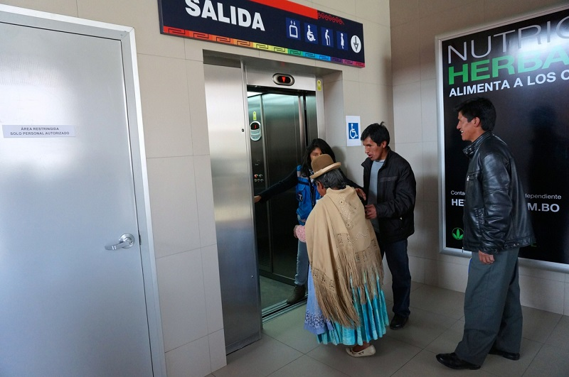 As an elderly passenger exited a car, a station attendant suggested that she take the elevator and helped her to board. Photo by Gwen Kash.