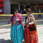 "Doñas Adelaida (left) and Estela ended their first trip on the teleférico at Taypi Uta (central station in the local Aymara language). Estela found the trip ""very beautiful."" Adelaida added, ""and very fast! On normal transit, it would have taken us an hour or an hour and a half!"" Photo by Gwen Kash."