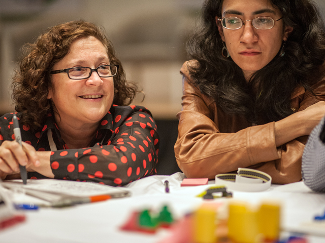 """Robin King (left) leads the """"Build Your Own City"""" workshop at X Congreso. See the cities that participants built during King's workshop here. Photo by Benoit Colin/EMBARQ."""