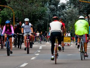 Residents bike through the streets of Bogotá, Colombia. Photo by Dario Hidalgo.