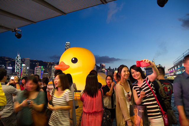 In addition to generating enormous excitement wherever it travels, the giant rubber duck sculpture shows the role of public art for economic stimulus. Photo by Ricky Chan/Flickr.
