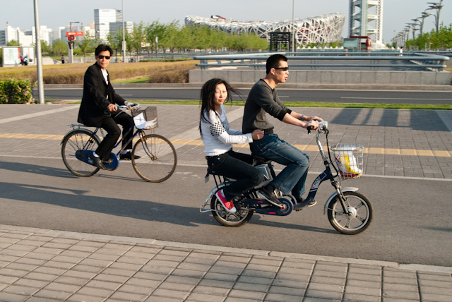 Separated bike lanes – like those in Beijing, pictured – improve bike safety and encourage active transport. Photo by Mike/Flickr.