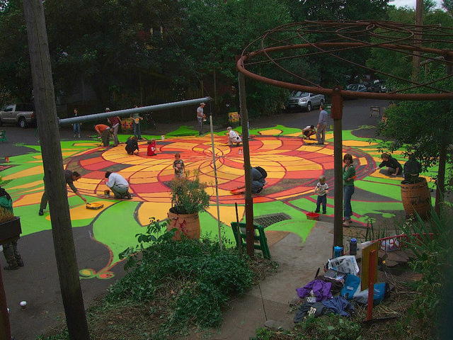 "In Portland, Oregon, an organization called ""City Repair"" paints a street mural. Photo by City Repair/Flickr."