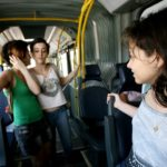 Residents of Rio de Janeiro—cariocas—are enjoying new transport options that connect them to employment, education, and leisure opportunities. Pictured here, three women take the city's TransOeste BRT to go to school. Photo by Benoit Colin/WRI.