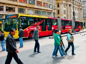 Bus rapid transit (BRT) systems, like Bogotá's TransMilenio, experience greater levels of ridership if their stations are located in urban environments that are dense, compact, and connected to mixed-use areas and public spaces. Photo by City Clock Magazine/Flickr.