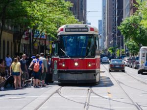 An icon of Toronto, the city's streetcar not only provides mobility within the urban core, but also integrates with regional transport to ensure transport access to residents on the periphery, as well. Photo by superherb/Flickr.