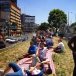 Picnickers in Mexico City reclaim a freeway median as public space. Photo by Ben Welle/Flickr.