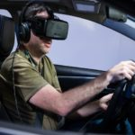 A driver using the Occulus Rift, a popular virtual reality device, to simulate a driving experience.  (Photo: Nan Palmero / Flickr)