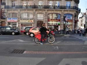 By aligning local and national policies and coordinating between sectors, Lille, France was able reduce transport emissions and save money. Photo by mi chiel/Flickr.