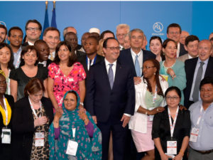 French President Hollande, center and the Youth Roundtable on Day 1 of the World Summit for Cities & Territories, Lyon, July 1-2, 2015. Photo Credit: Frank Trabouillet / Région Rhone Alpes