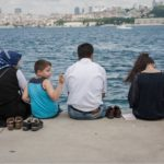 A family sits by the water in Istanbul, Turkey. Photo by Benoit Colin/WRI.