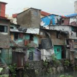 Informal urban housing, like this in Mumbai, is all that many new city-dwellers can afford. Photo by Robin King/WRI