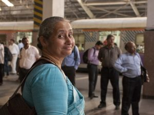 Woman waiting for her train at Mumbai Suburban Railway Western Line Church Gate Terminal, Mumbai, India. Photo by  Benoit Colin / EMBARQ / Flickr