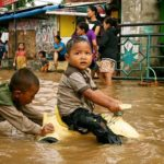 Children play in flood waters after torrential rains in Kampung Melayu, Jakarta. Photo by Kate Lamb, Freelance journalist.