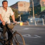Chinese Citizen Cautiously Bikes Around Beijing. Photo by  Benoit Colin/WRI