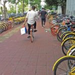 Chinese Cities Aim to Rein in Bike-Sharing Boom
